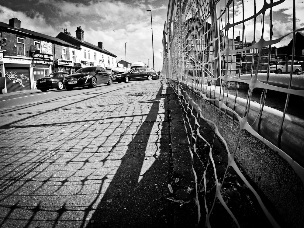 Shadow lines on the demolished corner of Mary Vale Rd